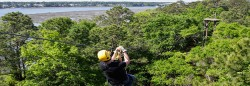 Man Ziplining over Hilton Head