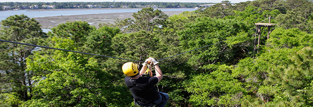 Man Ziplining over Hilton Head