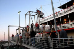 people in line waiting to board new orleans riverboat