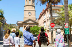 tourists on vacation taking a walking tour of historic charleston