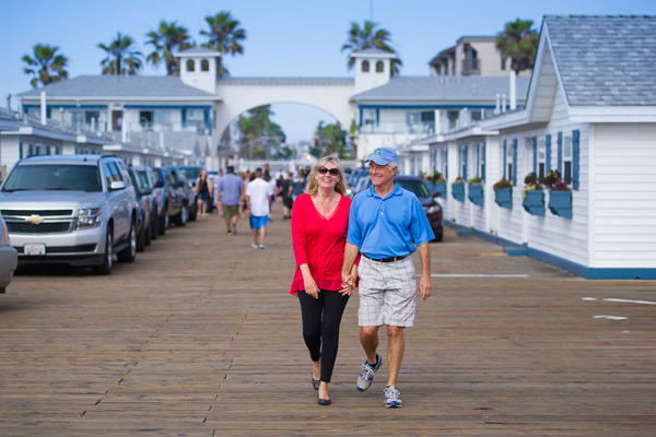Couple walking in La Jolla holding hands