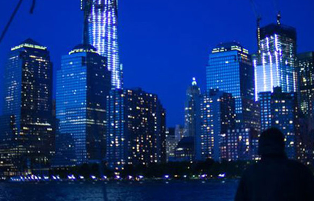View of New York Skyline at night from Harbor
